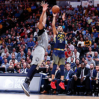 05 April 2018: Denver Nuggets guard Jamal Murray (27) takes a jump shot over Minnesota Timberwolves forward Taj Gibson (67) during the Denver Nuggets 100-96 victory over the Minnesota Timberwolves, at the Pepsi Center, Denver, Colorado, USA.