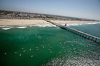 9 September 2009:  John Kissel memorial gathering northside at the Huntington Beach Pier. Over 150 surfers and friends gathered for a traditional surfers memorial service by paddling out on their boards and honoring their friend in the pacific ocean. Aerial photo from helicopter.