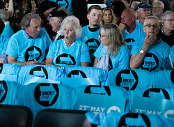 © Licensed to London News Pictures. 21/05/2019. London, UK. Brexit Party members gather at Olympia ahead of party leader Nigel Farage's European Election in London. Voters are due to go to the polls in two days. Photo credit: Peter Macdiarmid/LNP