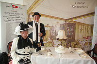 Miles Morgan Travel's Titanic Memorial Cruise leaves Southampton..Exactly1309 paying passengers from all over the world set sail from Southampton on a 12 night cruise to commemorate the centenary of the sinking of the Titanic..Carmel Bradburn and Andreas Storic from Adelaide, Australia dressed in period costume in a replica of the Titanic dining room.