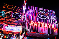 Neon lights along Walking Street, a popular area for go-go bars and restaurants in Pattaya, Thailand.