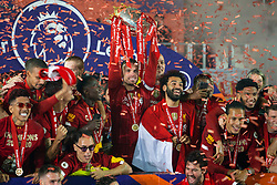 LIVERPOOL, ENGLAND - Wednesday, July 22, 2020: Liverpool's captain Jordan Henderson (C) lifts the Premier League trophy as the Reds are crowned Champions after the FA Premier League match between Liverpool FC and Chelsea FC at Anfield. The game was played behind closed doors due to the UK government's social distancing laws during the Coronavirus COVID-19 Pandemic. Roberto Firmino, Joel Matip, Dejan Lovren, goalkeeper Caoimhin Kelleher, Mohamed Salah, Georginio Wijnaldum, Virgil van Dijk, Joe Gomez. (Pic by David Rawcliffe/Propaganda)