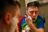 "Jack Schuler shaves his face Friday, May 20, 2016, in the bathroom of his apartment before heading to work at Lincoln High School in Des Moines. Schuler said he doesn't have much facial hair to shave since he started taking testosterone, but he wants to get into the habit of doing it now that he is living as a man. Schuler came out as transgender in April and is ""finally living his truth."" In the process, he has become Des Moines Public Schools' first transgender teacher."