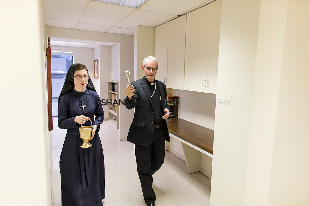 9/29/16 4:16:21 PM --  Bishop David Konderla blesses the newly remodeled Xavier Clinic in east Tulsa. <br /> <br /> Photo by Shane Bevel