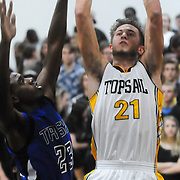 Topsail's Jake Sullivan shoots over Trask's Johnathan Jordan Friday December 5, 2014 at Topsail High School in Hampstead, N.C. (Jason A. Frizzelle)