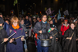 London, UK. 14 October, 2019. Climate activists from Extinction Rebellion are accompanied by the XR Samba band as they march in Cannon Street after vacating the busy junction in front of the Bank of England which they had occupied since 7am on the eighth day of International Rebellion protests.