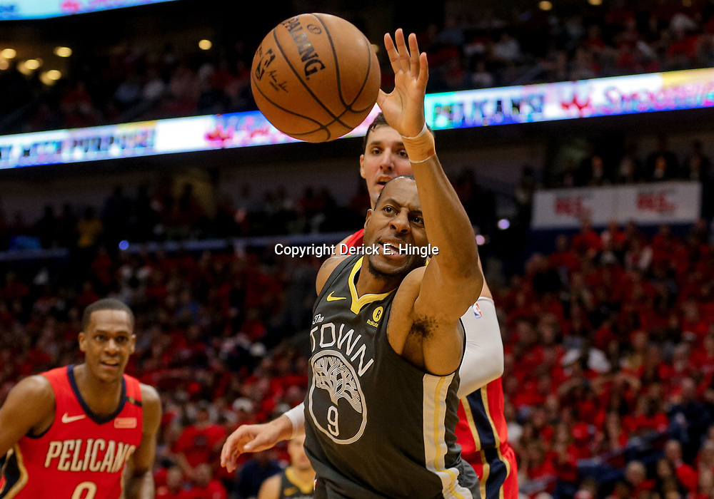 May 4, 2018; New Orleans, LA, USA; The ball goes out of bounds off Golden State Warriors forward Andre Iguodala (9) as New Orleans Pelicans forward Nikola Mirotic (3) and guard Rajon Rondo (9) defend during the second quarter in game three of the second round of the 2018 NBA Playoffs at Smoothie King Center. Mandatory Credit: Derick E. Hingle-USA TODAY Sports