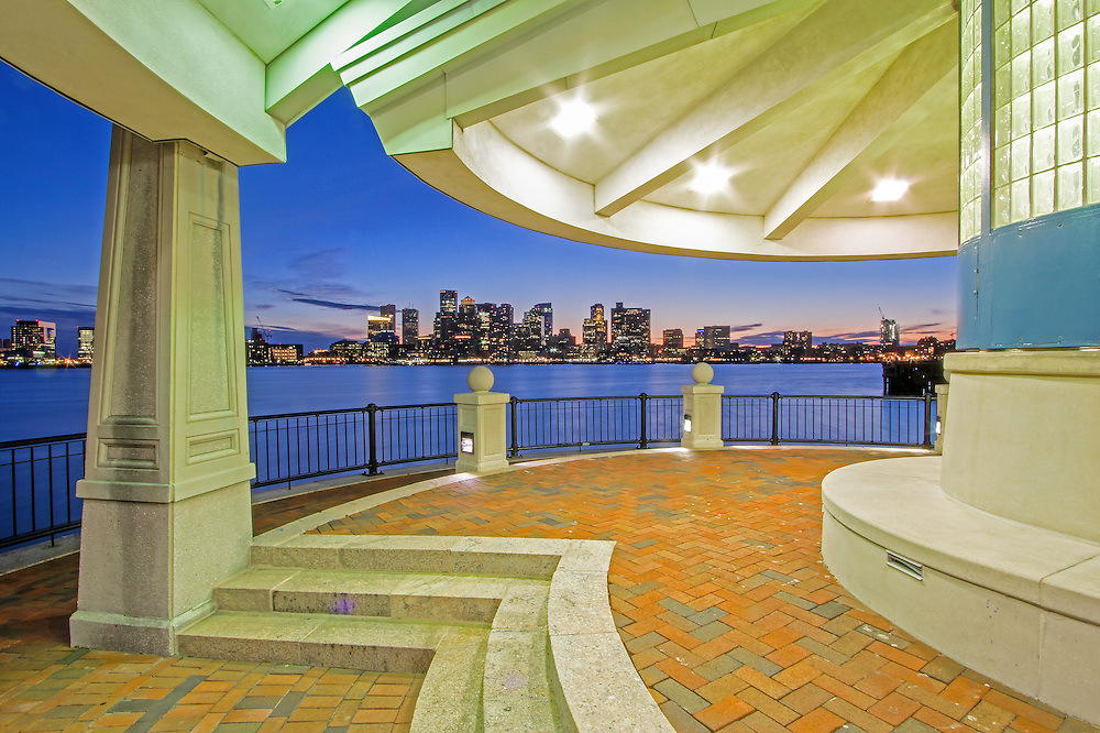 East Boston Piers Park photo of Boston is available as museum quality photography prints, canvas prints, acrylic prints or metal prints. Prints may be framed and matted to the individual liking and decorating needs:<br /> <br /> http://juergen-roth.pixels.com/featured/east-boston-piers-park-view-of-boston-juergen-roth.html<br /> <br /> East Boston Piers Park, Boston city skyline photography image from New England based fine art photographer Juergen Roth showing the Boston Harbor skyline with landmarks like Boston Downtown, Custom House of Boston, New England Aquarium, One International Place, Boston Marriott on Long Wharf, Commercial Wharf and Central Wharf captured on a beautiful night shortly after sunset at the blue hour of the night. The image was captured from Piers Park. Piers Park offers dramatic views of the Boston city skyline. <br /> <br /> Good light and happy photo making!<br /> <br /> My best,<br /> <br /> Juergen<br /> Fine Art Prints: www.RothGalleries.com<br /> Photo Blog: http://whereintheworldisjuergen.blogspot.com<br /> Twitter: @NatureFineArt<br /> Facebook: https://www.facebook.com/naturefineart