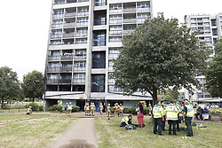 © Licensed to London News Pictures. 27/06/2020. London, UK. Fire brigade and other emergency services are dealinh with a fire in a block of flats in Kennington, south London. Evacuated residents received medical help on the grass outside their tower block. Photo credit: Peter Macdiarmid/LNP
