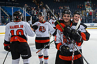 KELOWNA, BC - NOVEMBER 8: Elijah Brown #5 and Nick McCarry #36 of the Medicine Hat Tigers ceelbrate the win as they exit the ice against the Kelowna Rockets  at Prospera Place on November 8, 2019 in Kelowna, Canada. (Photo by Marissa Baecker/Shoot the Breeze)