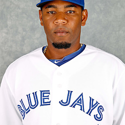 March 2, 2012; Dunedin, FL, USA; Toronto Blue Jays designated hitter Edwin Encarnacion (10) poses for a portrait during photo day at Florida Auto Exchange Stadium.  Mandatory Credit: Derick E. Hingle-US PRESSWIRE