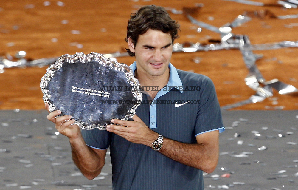 17 May 2009, Madrid --- Roger Federer of Switzerland poses with the trophy after winning the men singles final match of the ATP 1000 Mutua Madrilena Madrid Open at the Magic Box stadium in Madrid, Spain. Photo byJuan Manuel Serrano --- Image by ©Juan Manuel Serrano