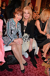 Left to right, KATHY LETTE and JOANNA LUMLEY at the LDNY Fashion Show and WIE Award Gala sponsored by Maserati held at The Goldsmith's Hall, Foster Lane, City of London on 27th April 2015.