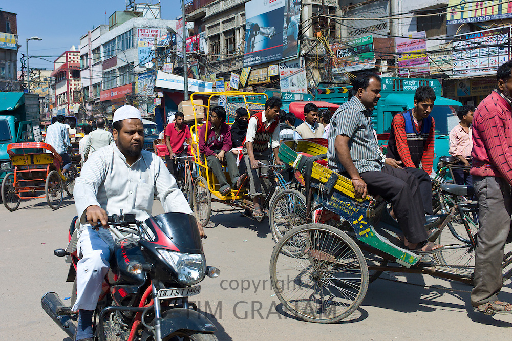 Crowded street scene at Chawri Bazar in Old Delhi, India