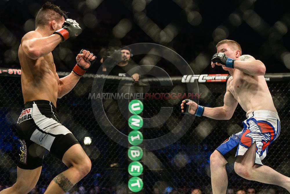 "STOCKHOLM, SWEDEN, JANUARY 24, 2015: Mirsad Bektic and Paul Redmond during ""UFC on Fox 14: Gustafsson vs. Johnson"" inside Tele2 Arena in Stockholm, Sweden"
