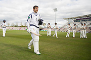 Rilee Rossouw of Hampshire walks off after being run out on 99 during the Specsavers County Champ Div 1 match between Hampshire County Cricket Club and Middlesex County Cricket Club at the Ageas Bowl, Southampton, United Kingdom on 16 April 2017. Photo by David Vokes.