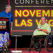November 11, 2015, Las Vegas, Nevada:<br /> Dave Tostenrude of the National Veteran's Wheelchair Games and Tom Brown of the Paralyzed Veterans of America speak at the General Session #2: Veterans Day at TEAMS '15 during the TEAMS Conference & Expo at Mandalay Bay Convention Center in Las Vegas, Nevada Wednesday, November 11, 2015.<br /> (Photo by Billie Weiss/TEAMS)