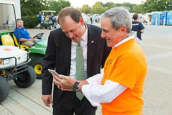 U.S. Congressman John Yarmuth D-Louisville, right shows a photo on his phone to U.S. Congressman Andy Barr R-Lexington outside the 53rd Annual Kentucky Farm Beureau Country Ham Breakfast. The annual charity event was protested by Yarmuth, Chris Hartman and other members of various fairness organizations outside the South Wing of the Kentucky Fair and Exposition Center, Thursday, Aug. 25, 2016 in Louisville.