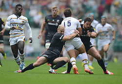 Saracens Inside Centre Brad Barritt and Saracens Fly-Half Charlie Hodgson tackle Wasps Full Back Rob Miller- Photo mandatory by-line: Alex James/JMP - 07966 386802 - 06/09/2014 - SPORT - RUGBY UNION - London, England - Twickenham Stadium - Saracens v Wasps - Aviva Premiership London Double Header.