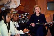 First lady Hillary Rodham Clinton listens to a group of local children at the new ''Mars Millennium'' exhibition at the National Air & Space Museum January 14, 1999 in Washington, DC.