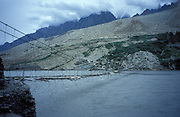 Gigantic suspension bridge in the karakorum mountains, near Passu on the Karakorum Highway, Northern Pakistan, asia