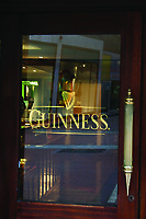 Guinness sign on glass door, Dublin, Ireland. Slightly blurred.