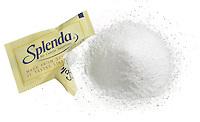 open splenda packet with a pile of splenda