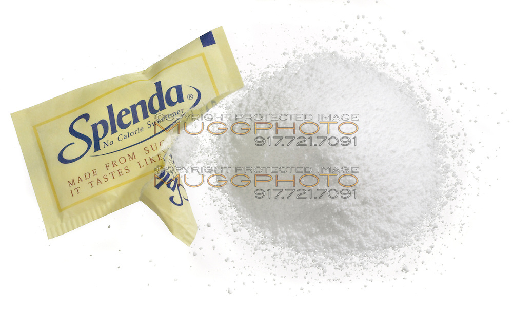 open splenda packet with a pile of splenda