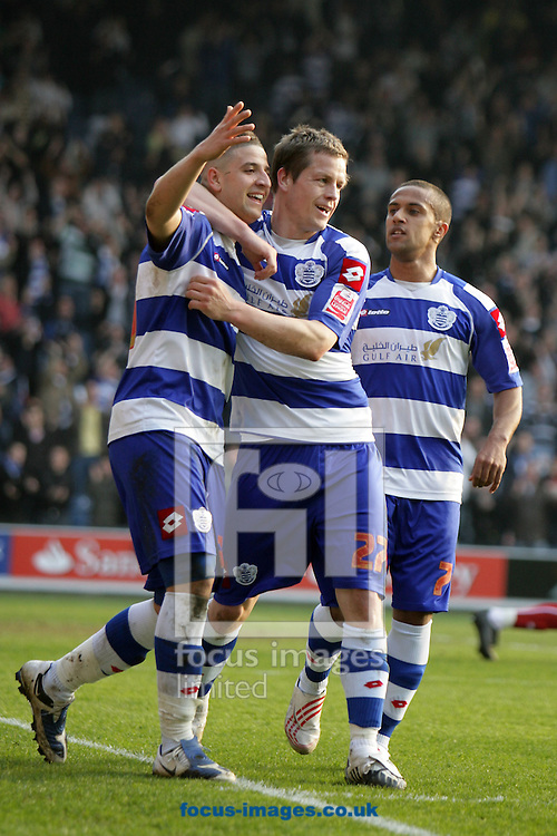 London - Saturday March 21st, 2009: Adel Taarabt of QPR celebrates scoring his side's second goal with team mates Heidar Helguson (C) and Wayne Routledge (R) during the Coca Cola Championship match at Loftus Road, London. (Pic by Mark Chapman/Focus Images)