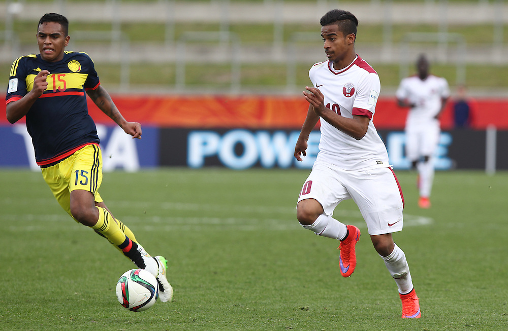 Akram Afif of Qatar takes off with Jhoan Ayala of Columbia in pursuit in the group c game of the FIFA u20 World Cup at Waikato Stadium, Hamilton, New Zealand, Sunday, May 31, 2015. Credit:SNPA / Ben Campbell