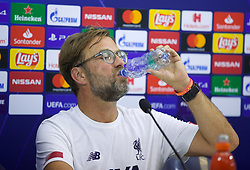 NAPLES, ITALY - Monday, September 16, 2019: Liverpool's manager Jürgen Klopp finishes a bottle of water after a long press conference in a very hot room at the Stadio San Paolo ahead of the UEFA Champions League Group E match between SSC Napoli and Liverpool FC. (Pic by David Rawcliffe/Propaganda)