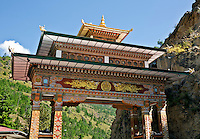 BU00009-00...BHUTAN - Ornate archway welcoming visitors to the Land of the Thunder Dragon at Chhuzon, (the Confluence of the Paro Chhum and the Thimphu Chhu to make the Wang Chhu).