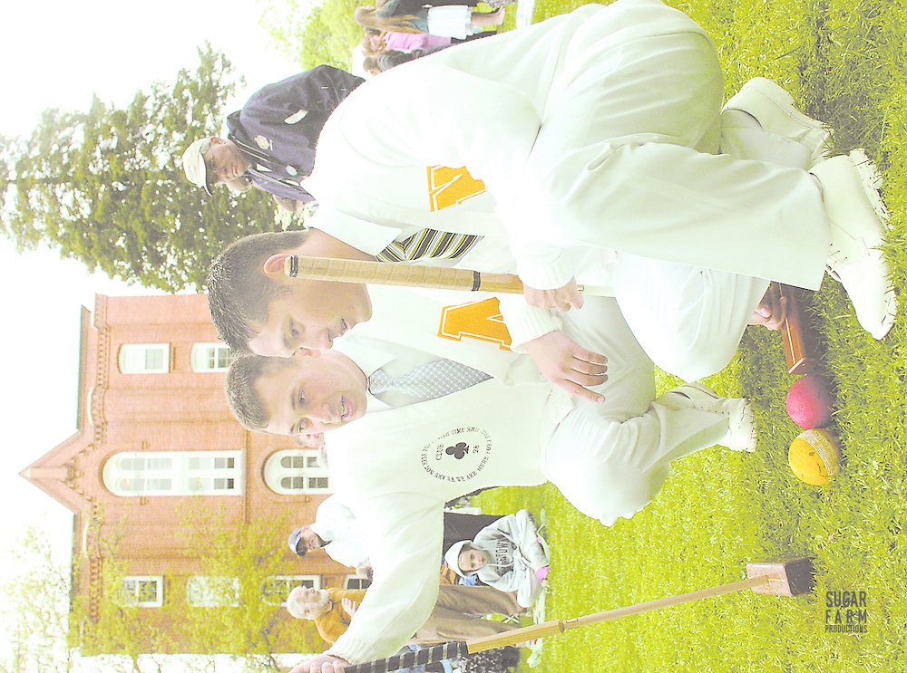 4/24/05: Naval Academy croquet players, (L) Pete Jovkov (05) and Troy Hokanson (05) discuss their strategy during the Navy-St. John's croquet match. Pete and Troy won their match..Photo by alison harbaugh