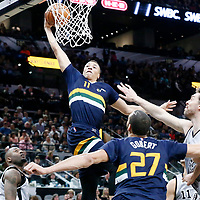 02 April 2017: Utah Jazz guard Dante Exum (11) goes for the dunk during the San Antonio Spurs 109-103 victory over the Utah Jazz, at the AT&T Center, San Antonio, Texas, USA.