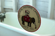 A National Historic Landmark sticker is posted on a window inside Lucy the Margate Elephant, Saturday, Aug. 17, 2002, in Margate, New Jersey. Lucy, a sixty-five-foot high, wooden elephant, which was built in 1881, was declared a national historic landmark in 1976. (Photo by William Thomas Cain/photodx.com)