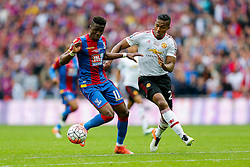 Wilfried Zaha of Crystal Palace is tackled by  Luis Antonio Valencia of Manchester United - Mandatory byline: Rogan Thomson/JMP - 21/05/2016 - FOOTBALL - Wembley Stadium - London, England - Crystal Palace v Manchester United - FA Cup Final.