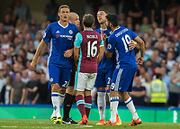 Football - 2016/2017 Premier League - Chelsea V West Ham United. <br /> <br /> John Terry of Chelsea restrains team mate Diego Costa as he remonstrates with the referee at Stamford Bridge.<br /> <br /> COLORSPORT/DANIEL BEARHAM
