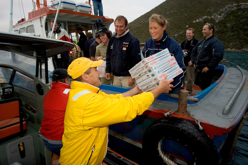 Volvo Ocean Race 2005-2006. Leg 2 - Albany/Eclipse Island, South Western Australia. Movistar passes the scoring gate of Eclipse Island. Due to new damage to their keel, they pull in to Albany to effect the necessary repairs before continuing on to the finish of Leg 2 in Melbourne. Pizzas are passed to the Albany Sea Rescue RIB to be transferred onto Movistar for the crew