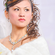 Brides in Taiwan traditionally wear elaborate hairstyles and copious amounts of makeup on their wedding day. Namasiya Township, Kaoshiung County, Taiwan