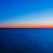 Panorama of the sun setting and the moon rising over Last Mountain Lake, Saskatchewan.