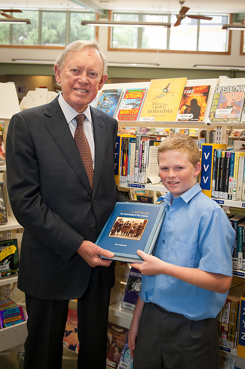 "Sir John Todd donates the book ""Enterprise and Energy - The Todd Family of NZ"" to a year 8 student. Wellesley College library opened by Rt. Hon. John Key, Prime Minister. Wednesday 21st March 2012...Photo by Mark Tantrum 