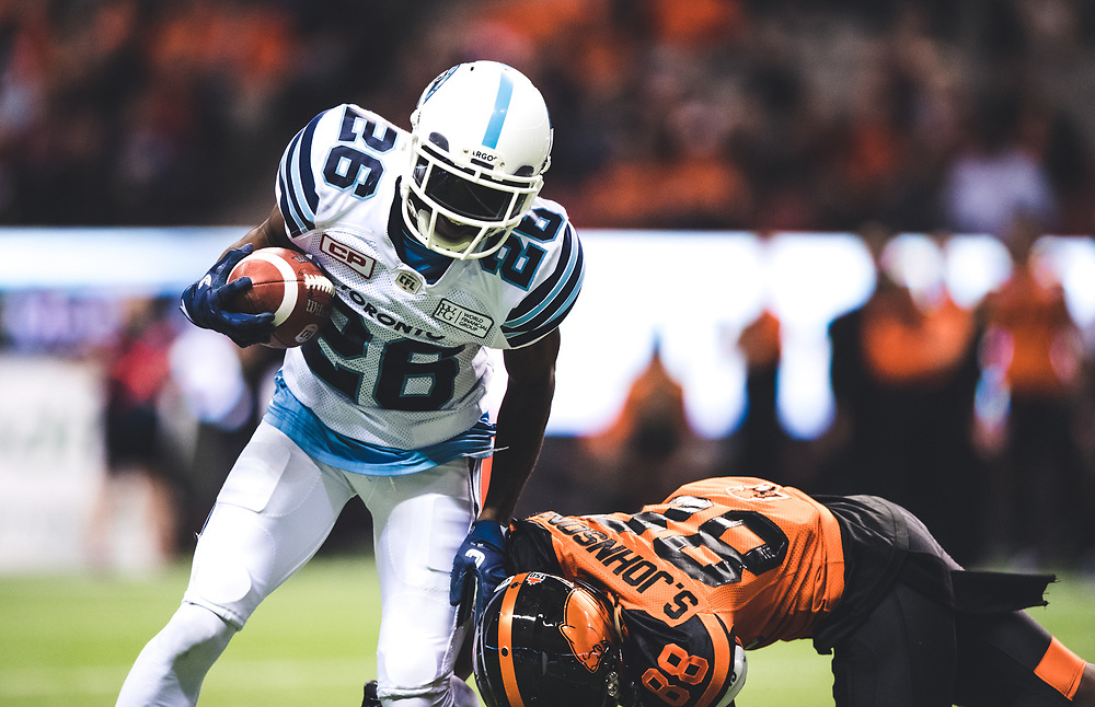 Cassius Vaughn (26) of the Toronto Argonauts and Shaq Johnson (88) of the BC Lions during the game at BC Place Stadium in Vancouver, BC, Saturday Nov. 4, 2017. (Photo: Johany Jutras)