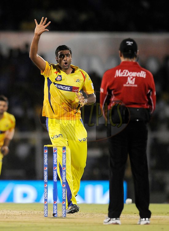 Ravichandran Ashwin of The Chennai Superkings appeals unsuccessfully for the wicket of Michael Hussey of the Mumbai Indians during the eliminator match of the Pepsi Indian Premier League Season 2014 between the Chennai Superkings and the Mumbai Indians held at the Brabourne Stadium, Mumbai, India on the 28th May  2014<br /> <br /> Photo by Pal PIllai / IPL / SPORTZPICS<br /> <br /> <br /> <br /> Image use subject to terms and conditions which can be found here:  http://sportzpics.photoshelter.com/gallery/Pepsi-IPL-Image-terms-and-conditions/G00004VW1IVJ.gB0/C0000TScjhBM6ikg