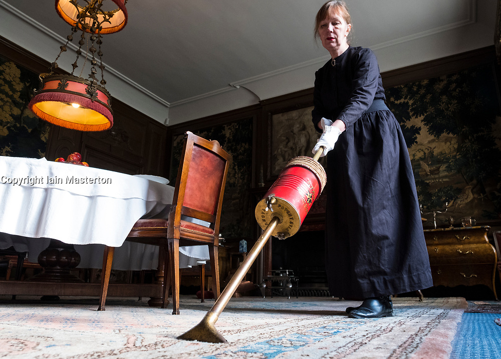 Edinburgh, Scotland, United Kingdom . 27th February, 2018. Volunteers wearing Edwardian costumes prepare to give Lauriston Castle in Edinburgh a Spring clean in preparation for the public opening later in the year. Pictured, Hilary Lovie uses a vintage Star Vacuum Cleaner
