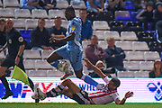 Exeter City defender Aaron Martin (5) tackles Coventry City striker Amadou Bakayoko (21) during the EFL Cup match between Coventry City and Exeter City at the Trillion Trophy Stadium, Birmingham, England on 13 August 2019.
