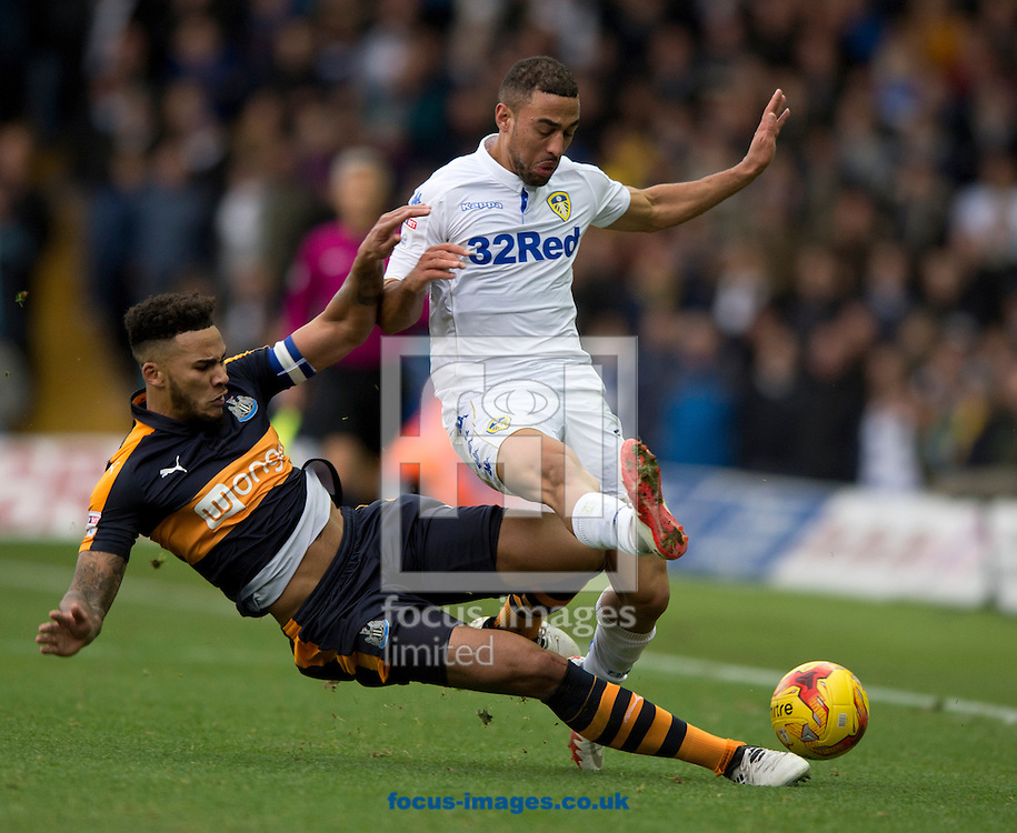 Kemar Roofe of Leeds United (right) and Jamaal Lascelles of Newcastle United challenge for the ball during the Sky Bet Championship match at Elland Road, Leeds<br /> Picture by Russell Hart/Focus Images Ltd 07791 688 420<br /> 20/11/2016