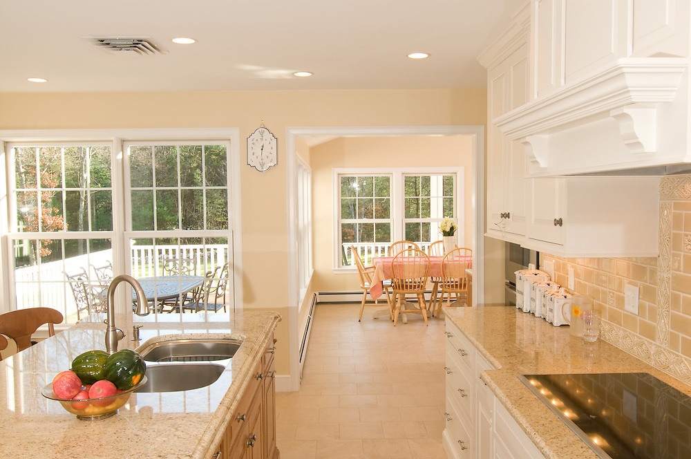 Kitchen and dining room of a private residence.