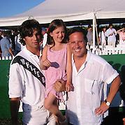 Peter Brant & Howard Sobel & Daughter.Polo Mercedes Benz BridgeHampton To Benefit.Leary Foundation.Hosted By Elizabeth hurley & Dennis Leary.BridgeHampton, New York.July 15, 2001.Photo By Antoine Desert/ CelebrityVibe.com..