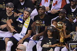 June 12, 2017 - Oakland, CA, USA - The Golden State Warriors celebrate after defeating the Cleveland Cavaliers, 129-120, in Game 5 of the NBA Finals at Oracle Arena in Oakland, Calif., on Monday, June 12, 2017. (Credit Image: © Jose Carlos Fajardo/TNS via ZUMA Wire)