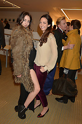 Left to right, sisters TISH WEINSTOCK and CELIA WEINSTOCK at Fashions for The Future presented by Oceana's Junior Council held at Phillips Auction House, 30 Berkeley Square, London on 19th March 2015.